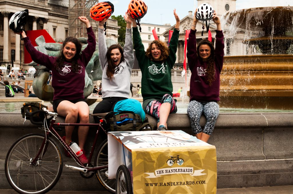 The HandleBards cheering with a bicycle and a trailer